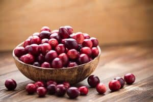 cranberries in a wooden bowl